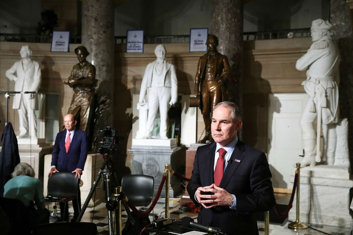 Commerce Secretary Wilbur Ross (L), and EPA Administrator Scott Pruitt (R) prepare to do television interviews in Statuary Hall at the U.S. Capitol before President Donald Trump delivers a speech to a joint session of Congress on February 28, 2017 in Washington, DC. Trump's first address to Congress is expected to focus on national security, tax and regulatory reform, the economy, and healthcare.
