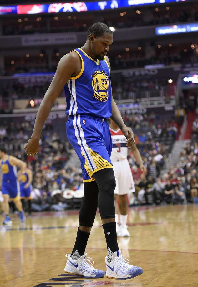 Kevin Durant walks to the bench after being injured in Tuesday night's game in Washington. The Warriors said Wednesday he will miss at least four weeks. Photo: Nick Wass, Associated Press