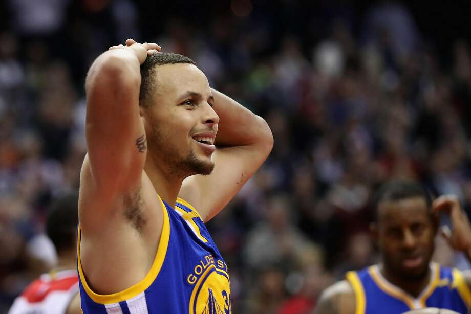 It was that kind of a night: Stephen Curry reacts after being called for a foul in the closing minute of the Warriors' 112-108 loss to Washington on Tuesday night. Photo: Rob Carr, Getty Images
