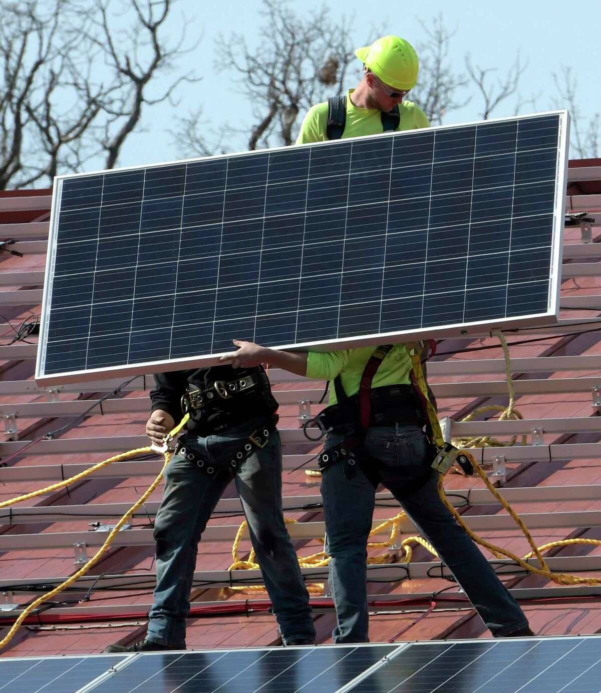 Workers from Monolith Solar install some of the 1396 panels that will cover both sides of the Knickerbacker Recreational Facility Tuesday Feb. 28, 2017 in Troy, N.Y. (Skip Dickstein/Times Union)