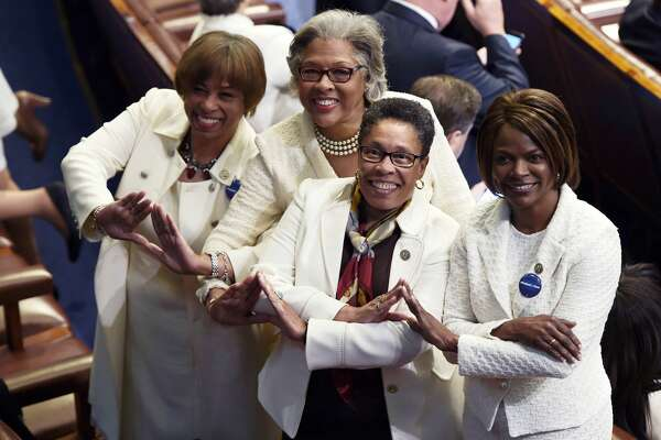 Members of congress wear white to honor the women's suffrage movement and support women's rights before US President Donald Trump addresses a joint session of the US Congress on February 28, 2017, in Washington, DC.