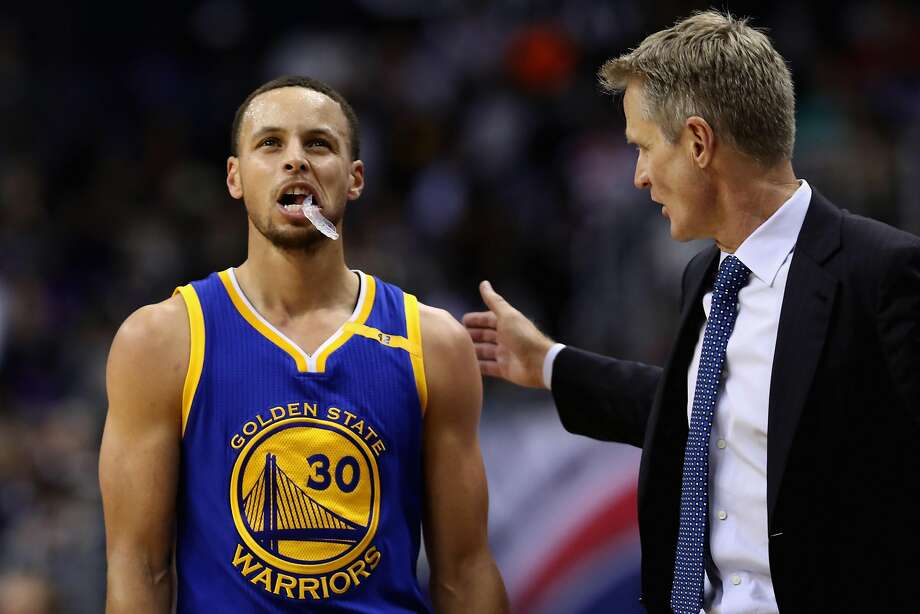 WASHINGTON, DC - FEBRUARY 28: Stephen Curry #30 of the Golden State Warriors talks with head coach Steve Kerr during a first half time out against the Washington Wizards at Verizon Center on February 28, 2017 in Washington, DC. NOTE TO USER: User expressly acknowledges and agrees that, by downloading and or using this photograph, User is consenting to the terms and conditions of the Getty Images License Agreement.  (Photo by Rob Carr/Getty Images) Photo: Rob Carr, Getty Images