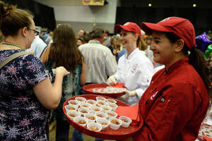 Maelyn Tonder with the Lamar University culinary program hands out chocolate chip cheese truffles at the Taste of the Triangle at the Beaumont Civic Center on Tuesday night.  Photo taken Tuesday 2/28/17 Ryan Pelham/The Enterprise