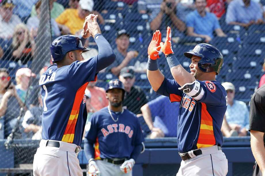 The Astros' Carlos Correa, left, congratulates Carlos Beltran for hitting the first home run, a two-run shot in the fourth inning off the Nationals' Oliver Perez, at the Ballpark of the Palm Beaches. Photo: Joel Auerbach, Stringer / 2017 Getty Images
