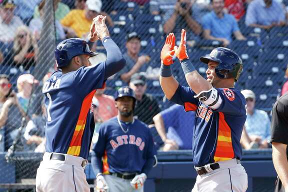 The Astros' Carlos Correa, left, congratulates Carlos Beltran for hitting the first home run, a two-run shot in the fourth inning off the Nationals' Oliver Perez, at the Ballpark of the Palm Beaches.