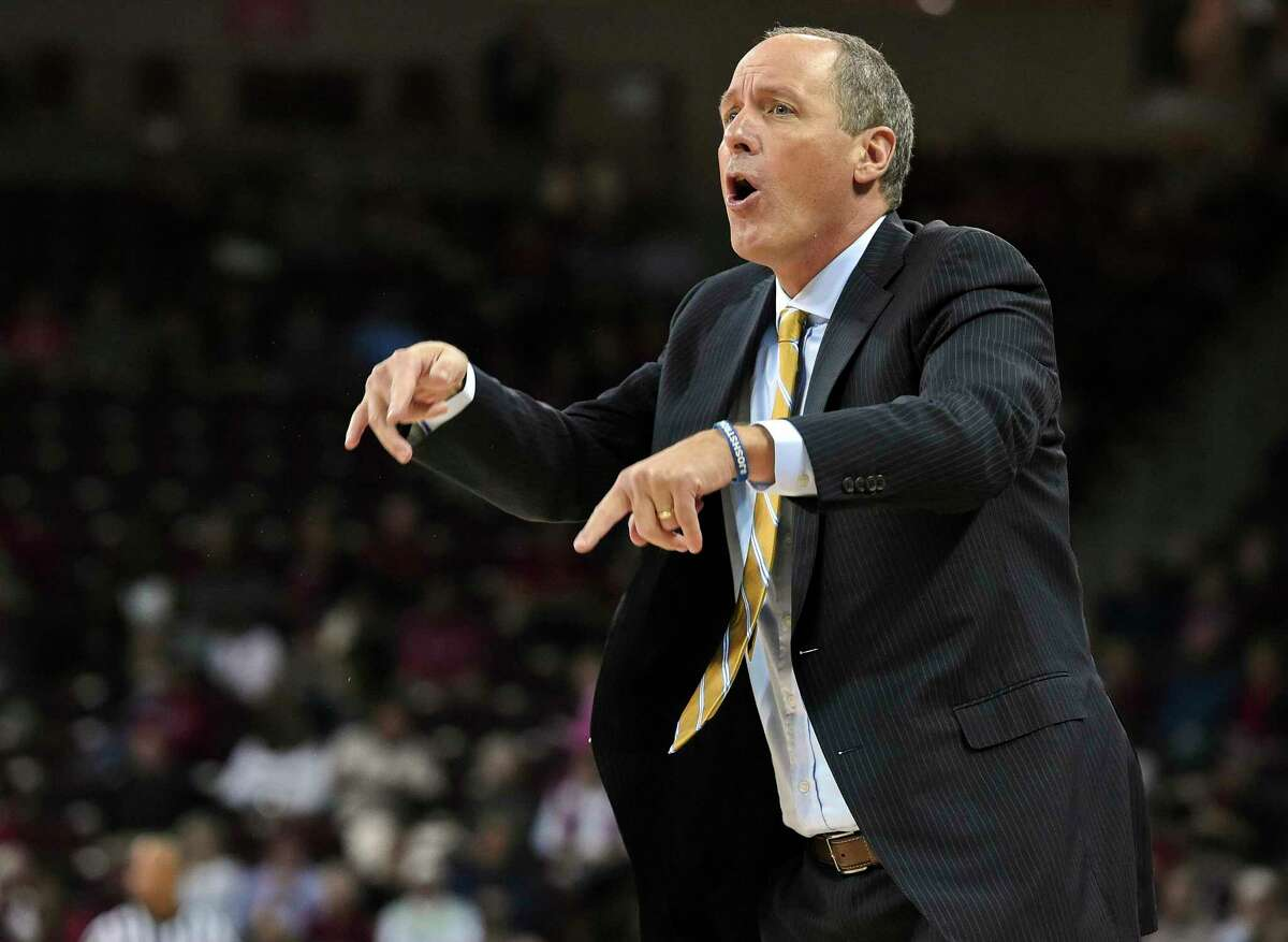 FILE- In this Dec. 1, 2016, file photo, Vermont head coach John Becker reacts during the first half of an NCAA college basketball game against South Carolina in Columbia, S.C. The longest winning streak in the 117-year history of Vermont basketball, 18 games, is now the longest current winning streak in all of NCAA Division I. The Catamounts (26-5) took over the top spot Saturday night, Feb. 25, 2017, after then top-ranked Gonzaga (29-1) lost to BYU. (AP Photo/Richard Shiro, File) ORG XMIT: NY159