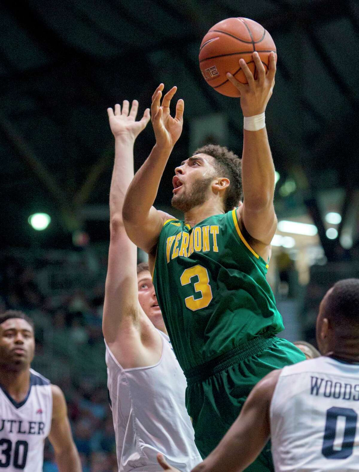 FILE - In this Dec. 21, 2016, file photo, Vermont forward Anthony Lamb (3) drives the ball through the Butler defense to put up a shot in the first half of an NCAA college basketball game in Indianapolis. The longest winning streak in the 117-year history of Vermont basketball, 18 games, is now the longest current winning streak in all of NCAA Division I. The Catamounts (26-5) took over the top spot Saturday night, Feb. 25, 2017, after then top-ranked Gonzaga (29-1) lost to BYU. (AP Photo/Doug McSchooler, File) ORG XMIT: NY160