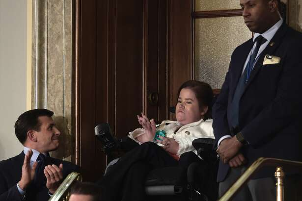 Megan Crowley (C) is recognized as US President Donald Trump addresses a joint session of the US Congress on February 28, 2017, in Washington, DC.