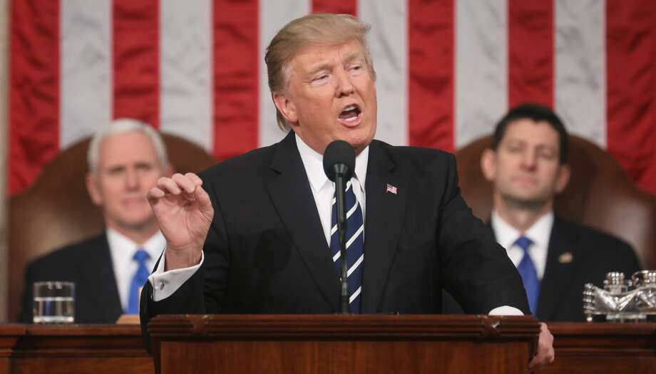 President Donald J. Trump (C) delivers his first address to a joint session of the U.S. Congress as U.S. Vice President Mike Pence (L) and Speaker of the House Paul Ryan (R) listen on February 28, 2017 in the House chamber of the U.S. Capitol in Washington, DC. Trump's first address to Congress is expected to focus on national security, tax and regulatory reform, the economy, and healthcare. Photo: Pool/Getty Images