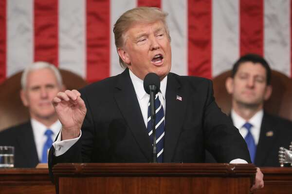 President Donald J. Trump (C) delivers his first address to a joint session of the U.S. Congress as U.S. Vice President Mike Pence (L) and Speaker of the House Paul Ryan (R) listen on February 28, 2017 in the House chamber of the U.S. Capitol in Washington, DC. Trump's first address to Congress is expected to focus on national security, tax and regulatory reform, the economy, and healthcare.