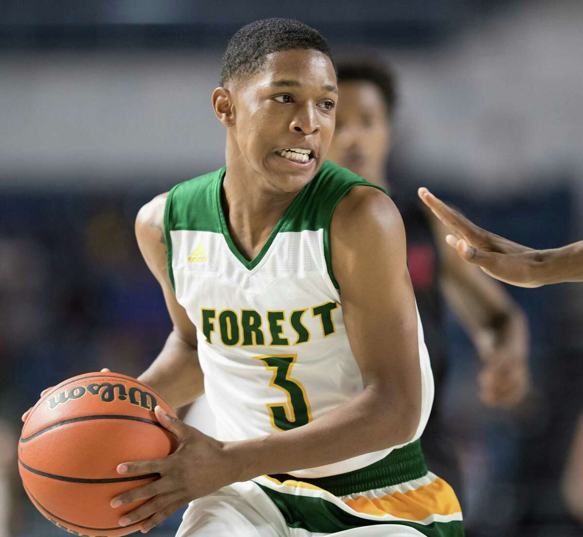 Taj Simmons (3) of the Klein Forest Eagles looks to pass the ball against the Westfield Mustangs in a 6A Bi-District playoff game on Tuesday, February 28, 2017 at the Delmar Fieldhouse in Houston, Texas.