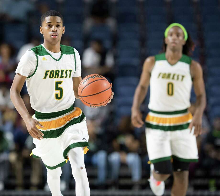 Reggie Miller (5) of the Klein Forest Eagles brings the ball up the court against the Westfield Mustangs in a 6A Bi-District playoff game on Tuesday, February 28, 2017 at the Delmar Fieldhouse in Houston, Texas. Photo: Wilf Thorne, For The Chronicle / © 2017 Houston Chronicle