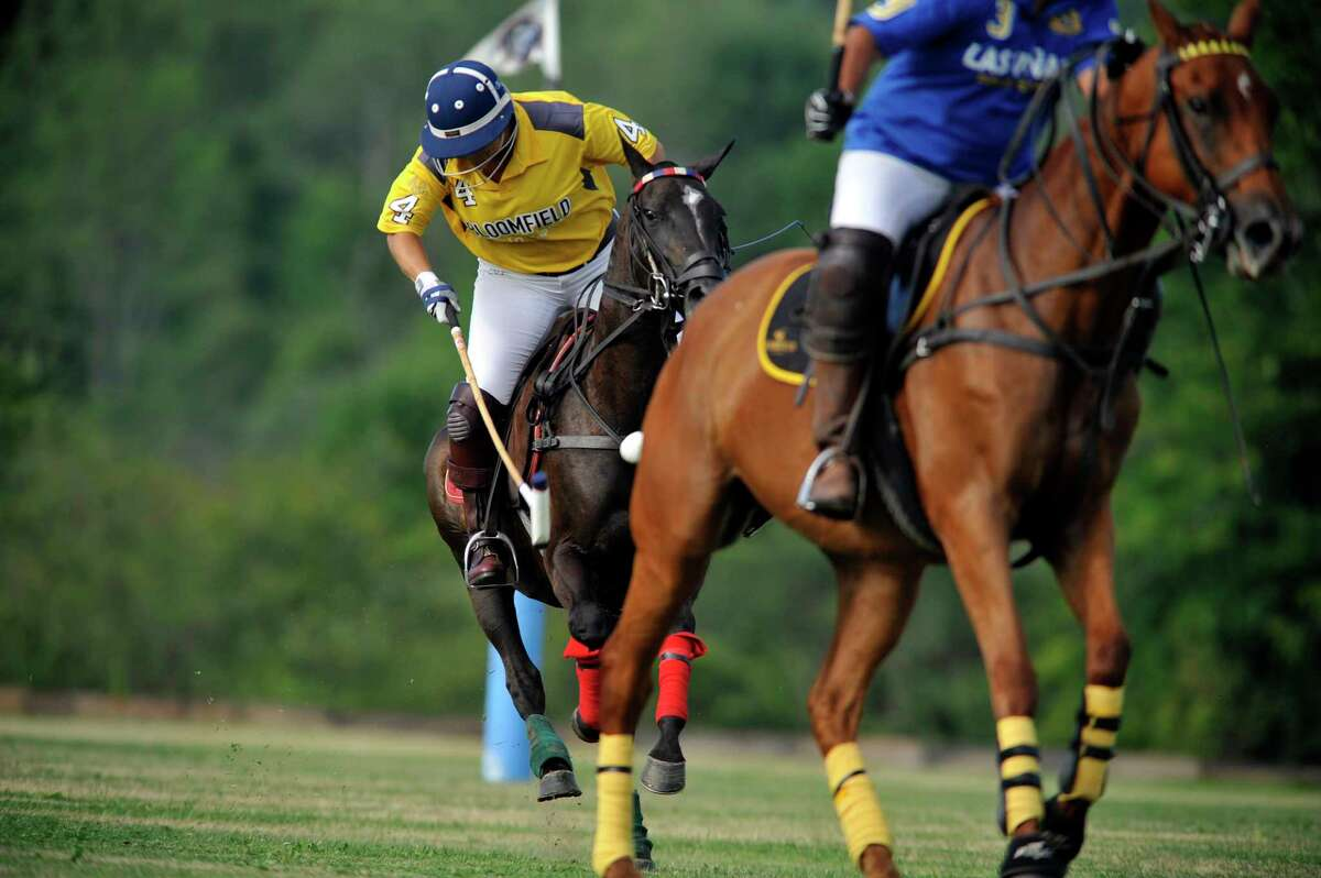 Sunny Hale with Bloomfield hits the ball during the Veuve Clicquot Challenge Tournament Finals at the Saratoga Polo grounds on Sunday, July 24, 2016, in Greenfield Center, N.Y. The next tournament is July 29th at 5:30pm. (Paul Buckowski / Times Union)