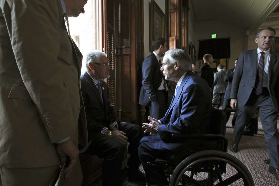 Rep. Dan Huberty, seen chatting with Gov. Greg Abbott, chairs the House Public Education Committee. Photo: Tom Reel / San Antonio Express-News / San Antonio Express-News