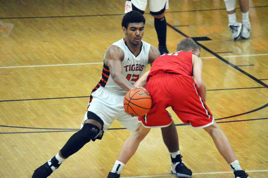 Edwardsville senior guard Mark Smith, left, knocks the ball away for a steal.