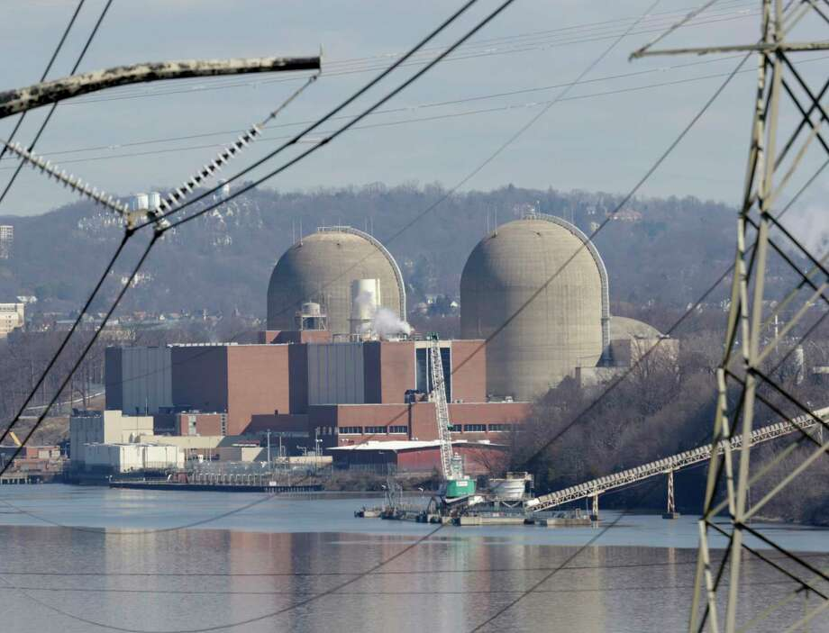 Indian Point Energy Center is seen in Buchanan, N.Y., Tuesday, Feb. 28, 2017. Some New York lawmakers are demanding more information about plans to close Indian Point nuclear plant in suburban New York City by 2021. (AP Photo/Seth Wenig) ORG XMIT: NYSW104 Photo: Seth Wenig / Copyright 2017 The Associated Press. All rights reserved.