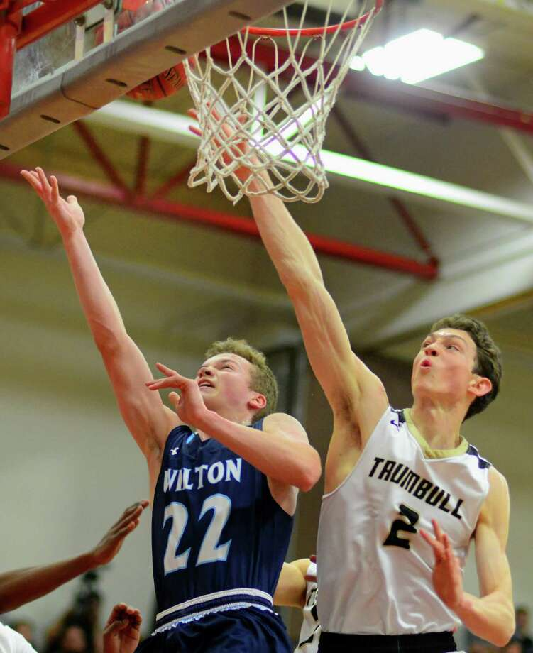 Wilton's Andrew Connolly lays up the ball as Trumbull's John Lynch defends during FCIAC Boys Basketball Semifinal action in Fairfield, Conn., on Tuesday Feb. 28, 2017. Photo: Christian Abraham / Hearst Connecticut Media / Connecticut Post
