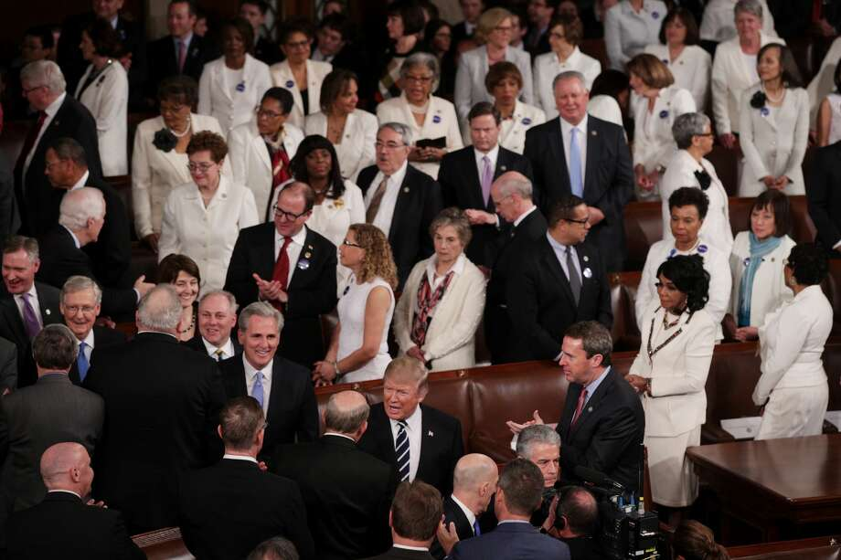 President Donald Trump arrives to address a joint session of the U.S. Congress, as members of congress wear white to honor the women's suffrage movement and support women's rights, February 28, 2017 in the House chamber of  the U.S. Capitol in Washington, DC. Trump's first address to Congress focused on national security, tax and regulatory reform, the economy, and healthcare. Photo: Alex Wong/Getty Images