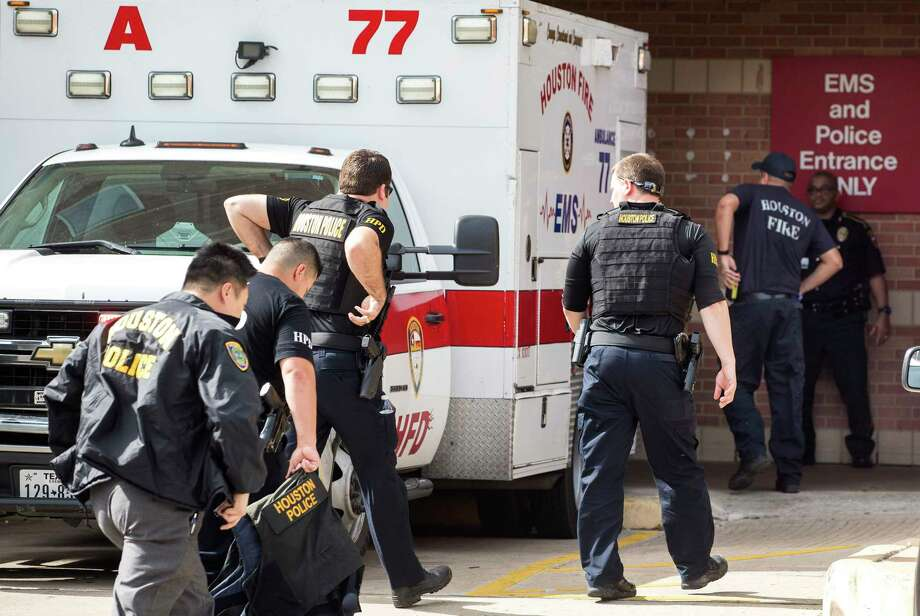 Officers arrive at Ben Taub Hospital, where their colleague, Jose Muñoz, was taken. Officer Ronny Cortez was taken to Memorial Hermann Hospital. Photo: Brett Coomer, Staff / © 2017 Houston Chronicle
