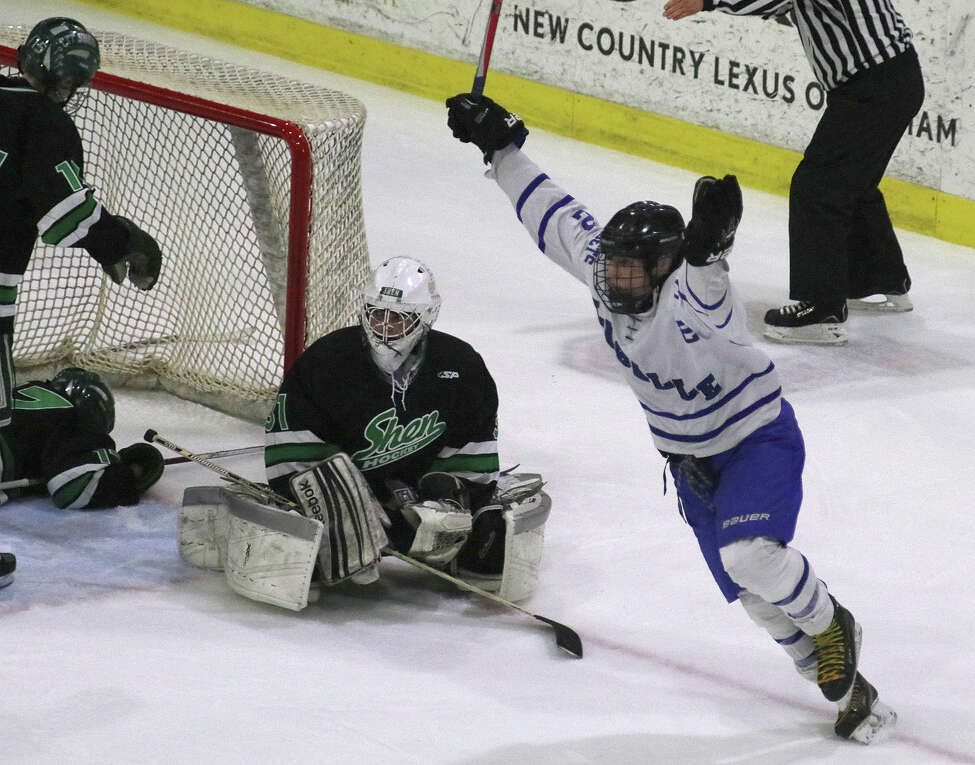 Shen goalie Jared Vandeloo sits by his net as La Salle's Kevin Mainello celebrates his game winning goal in the 5th period against Shen during the Section II Division I Hockey final at Union College in Schenectady Tuesday, February 28, 2017. (Ed Burke-Special to The Times Union)