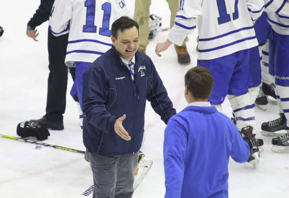 La Salle coach Tim Flanigan shares a smile and a shake after the Cadets defeated Shenendehowa in overtime during the Section II Division I Hockey final at Union College in Schenectady Tuesday, February 28, 2017. (Ed Burke-Special to The Times Union)