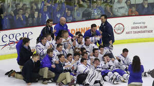 La Salle Cadets crowd the ice after their overtime victory over Shen in the Section II Division I Hockey final at Union College in Schenectady Tuesday, February 28, 2017. (Ed Burke-Special to The Times Union)