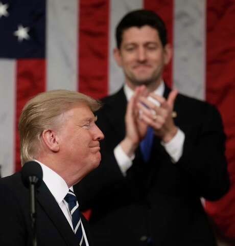 President Donald Trump smiles at the end of his addresses to a joint session of Congress on Capitol Hill in Washington, Tuesday, Feb. 28, 2017, as House Speaker Paul Ryan applauds. (Jim Lo Scalzo/Pool Image via AP) Photo: Jim Lo Scalzo, AP / Pool EPA