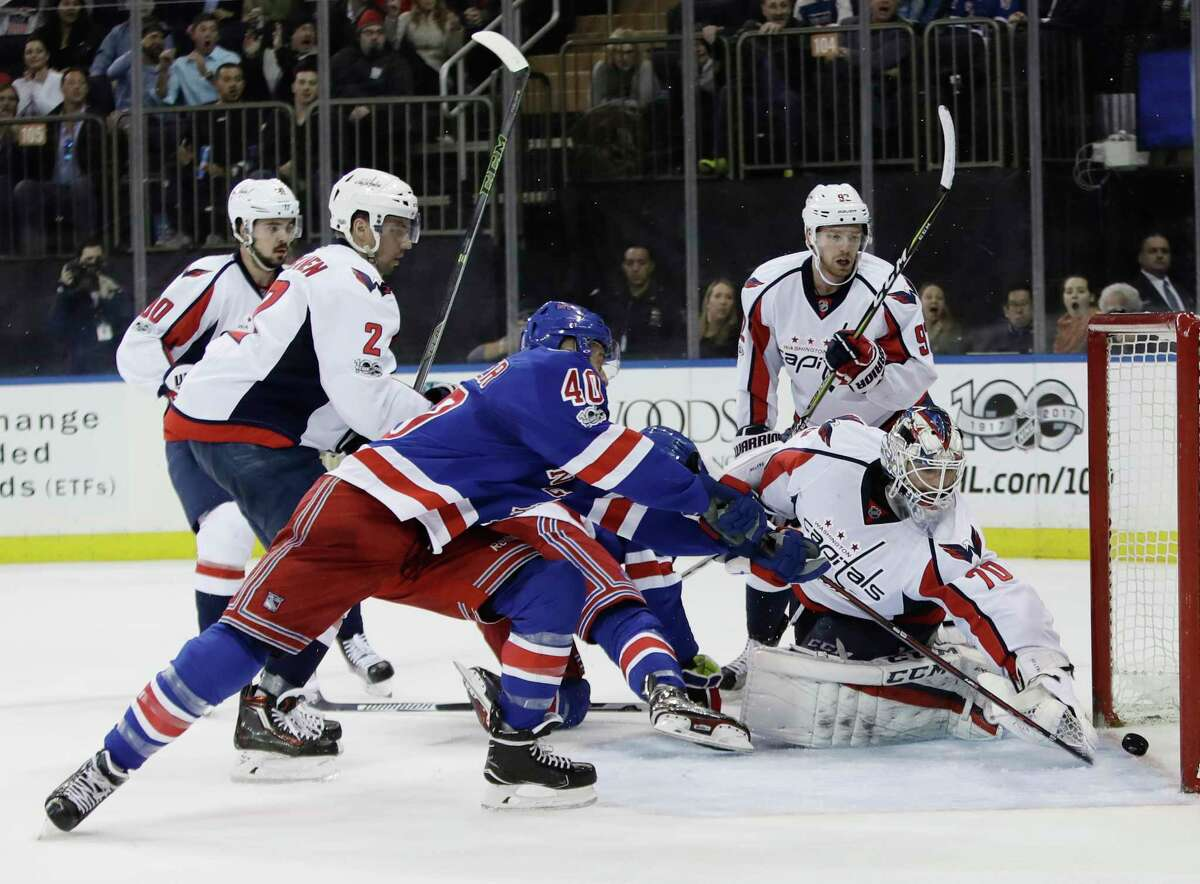 Washington Capitals goalie Braden Holtby (70) reaches for a puck shot by New York Rangers' Michael Grabner (40) during the second period of an NHL hockey game, Tuesday, Feb. 28, 2017, in New York. After a review, the goal was overturned. (AP Photo/Frank Franklin II) ORG XMIT: MSG109
