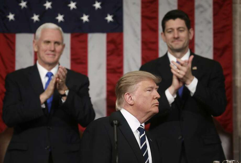 President Trump addresses Congress Tuesday as House Speaker Paul Ryan and Vice President Mike Pence applaud. Photo: Jim Lo Scalzo / Jim Lo Scalzo / Associated Press / Pool EPA