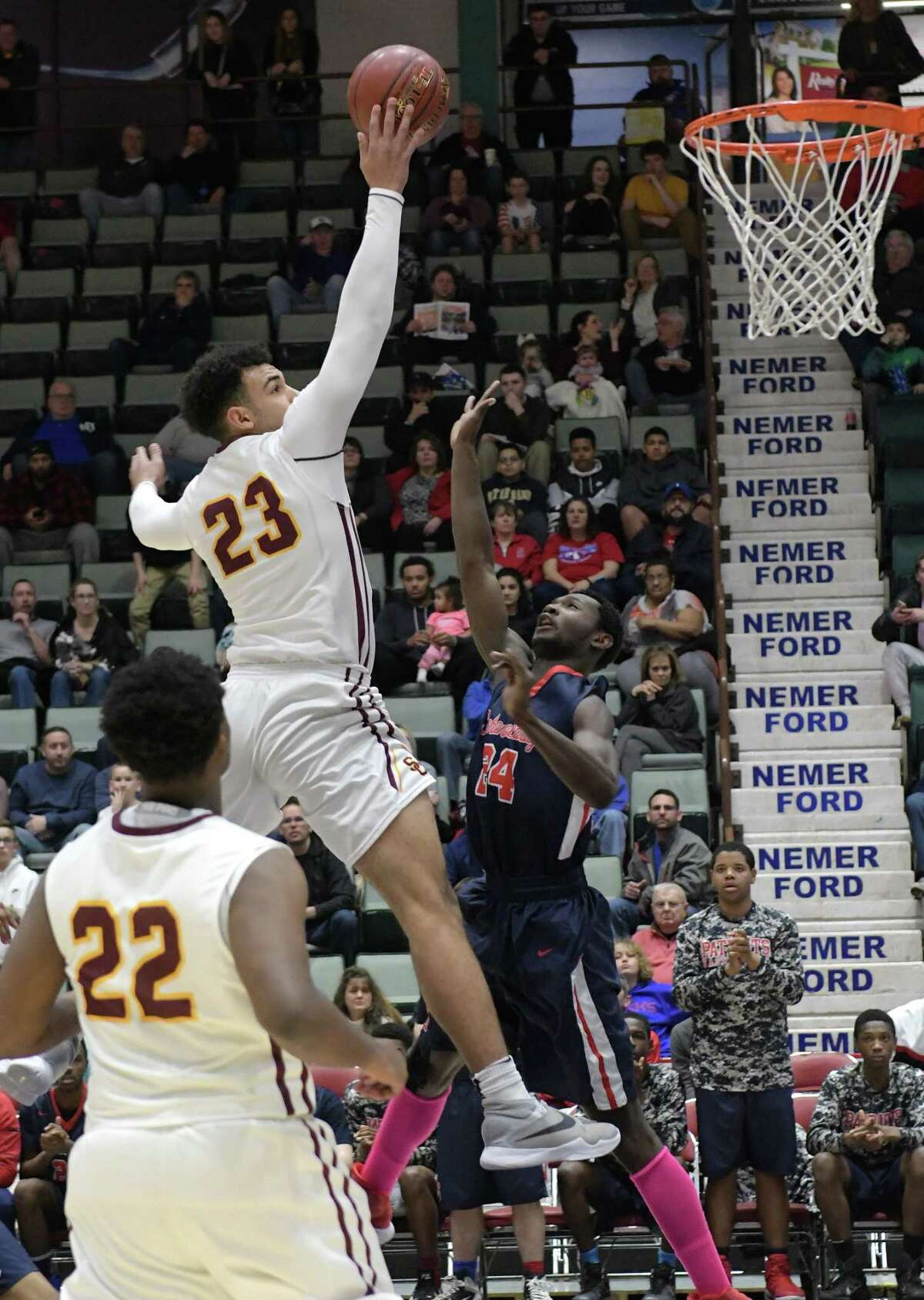 Isaiah Moll of Colonie drives to the basket over John Ryals of Schenectady during their Class AA semifinal game at the Glens Falls Civic Center on Tuesday, Feb. 28, 2017, in Glens Falls, N.Y. (Paul Buckowski / Times Union)