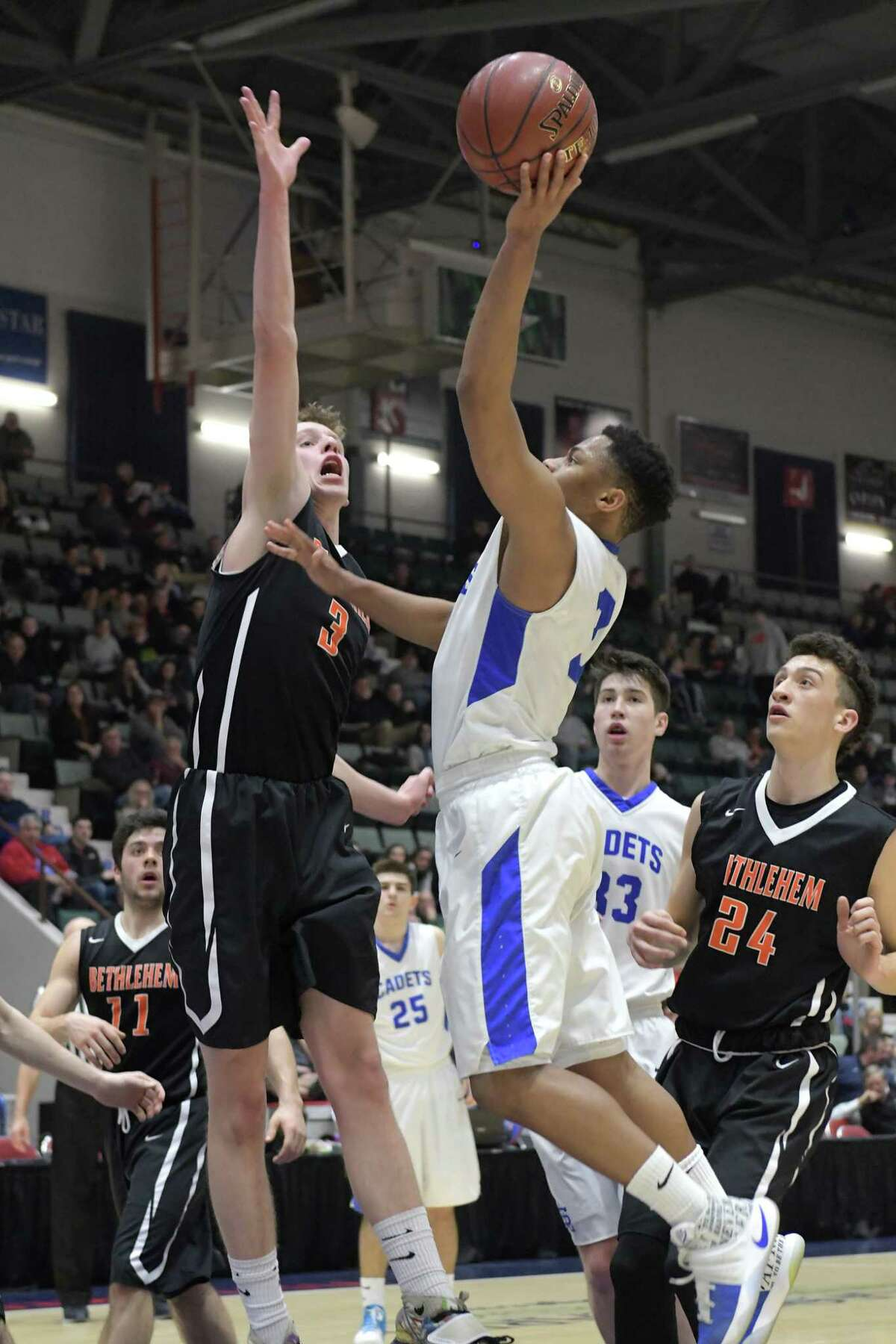 Hayden Thompson of Bethlehem, left, tries to block the shot of Raymond Evans of La Salle Institute, during their Class AA semifinal game at the Glens Falls Civic Center on Tuesday, Feb. 28, 2017, in Glens Falls, N.Y. (Paul Buckowski / Times Union)