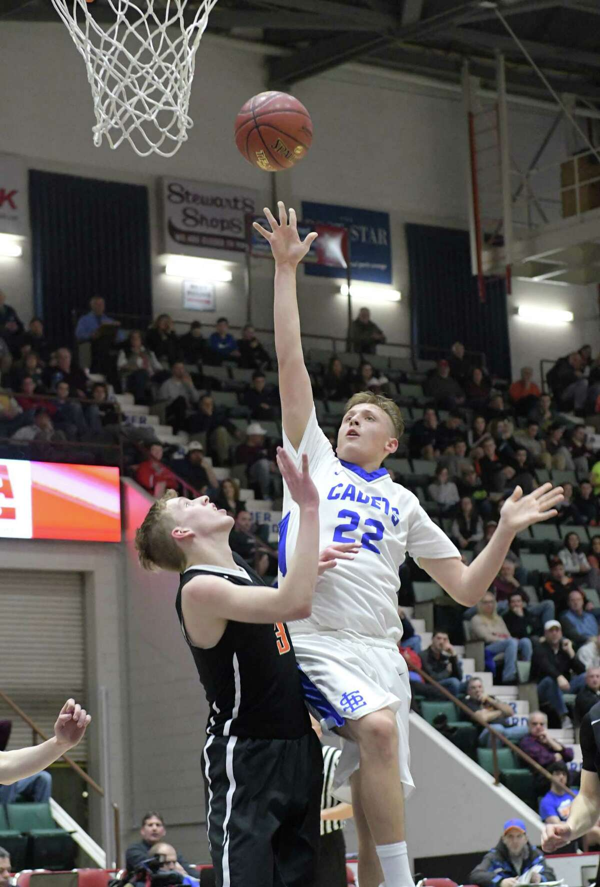 Seth LaForest of La Salle Institute puts up a shot over a Bethlehem player during their Class AA semifinal game at the Glens Falls Civic Center on Tuesday, Feb. 28, 2017, in Glens Falls, N.Y. (Paul Buckowski / Times Union)