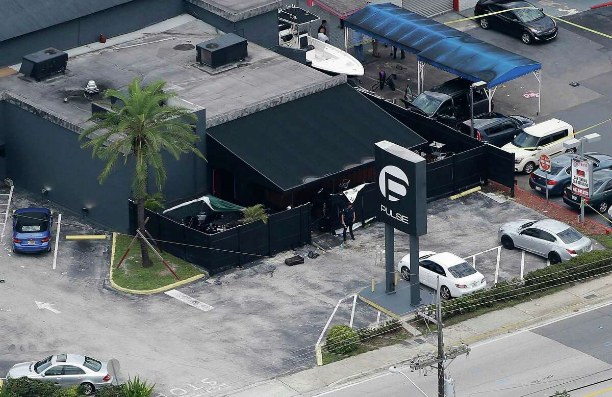 FILE - In this June 12, 2016 file photo, law enforcement officials work at the Pulse gay nightclub in Orlando, Fla., following a mass shooting. A California judge is deciding whether to release the widow of the gunman, Omar Mateen, who killed dozens of people at the Florida nightclub and is accused of helping him. A hearing is set in federal court in Oakland, Calif., on Wednesday, March 1, 2017, to determine whether Noor Salman must stay behind bars while she awaits trial.