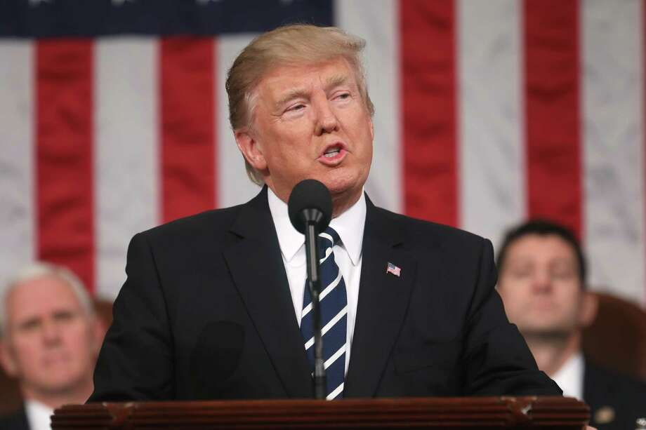 WASHINGTON, DC - FEBRUARY 28:  (AFP OUT) U.S. President Donald Trump addresses a joint session of the U.S. Congress on February 28, 2017 in the House chamber of the U.S. Capitol in Washington, DC. Trump's first address to Congress is expected to focus on national security, tax and regulatory reform, the economy, and healthcare. (Photo by Jim Lo Scalzo - Pool/Getty Images) ORG XMIT: 700003147 Photo: Pool / 2017 Getty Images