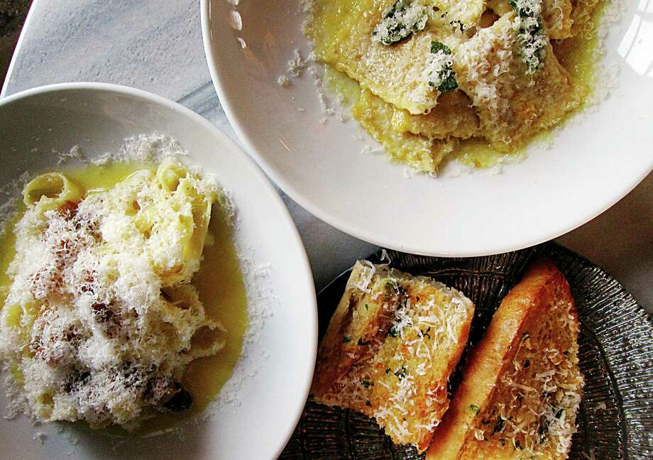 Fettuccine carbonara, left, and pumpkin ravioli at Battalion. Photo: Mike Sutter /San Antonio Express-News