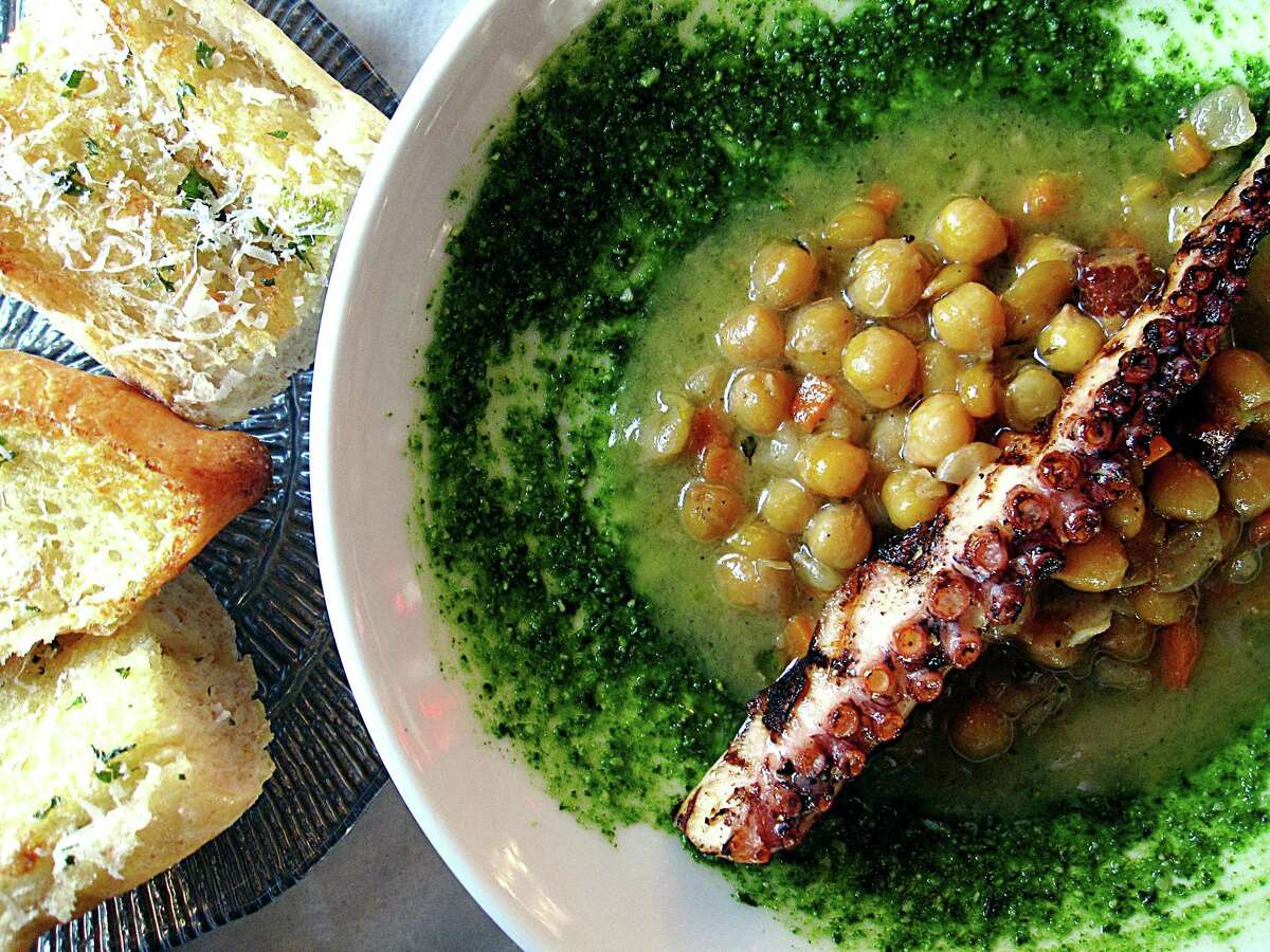 Grilled octopus with braised chickpeas, guanciale and basil pesto from Battalion.