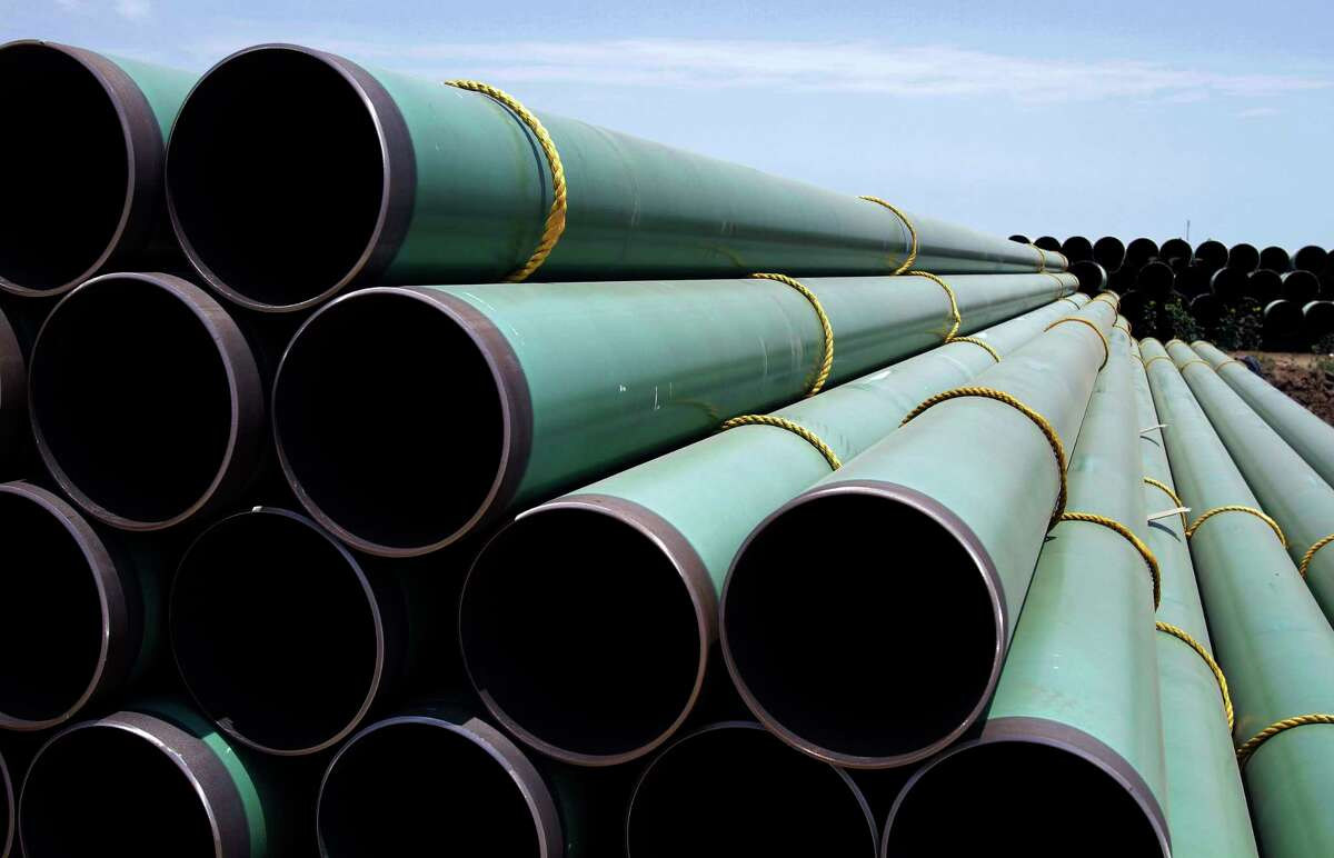 In this May 15, 2011 photo, hundreds of drilling pipes are stacked at a rail center in Gardendale, Texas. AmericaÂ?'s plan to use more natural gas to run power plants, make chemicals, drive vehicles and heat homes has been called into question by 2014's very tough winter. (AP Photo/Pat Sullivan, File)