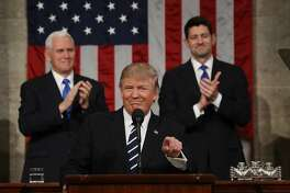 WASHINGTON, DC - FEBRUARY 28:  (AFP OUT) U.S. Vice President Mike Pence (L) and Speaker of the House Paul Ryan (R) applaud as U.S. President Donald J. Trump (C) arrives to deliver his first address to a joint session of the U.S. Congress on February 28, 2017 in the House chamber of the U.S. Capitol in Washington, DC. Trump's first address to Congress is expected to focus on national security, tax and regulatory reform, the economy, and healthcare. (Photo by Jim Lo Scalzo - Pool/Getty Images) *** BESTPIX ***