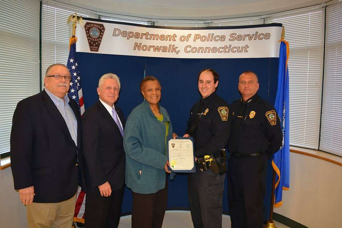 Two Norwalk police officers, including Brendan Collins (second from right) were elevated to the rank of detective, and another detective was promoted to sergeant.