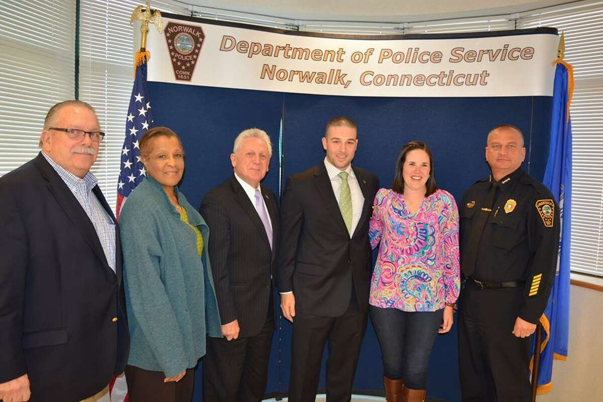Two Norwalk police officers were elevated to the rank of detective, and another detective, Justin Bisceglie (third from right) was promoted to sergeant.