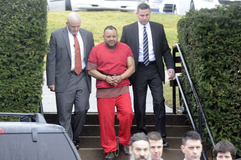 Oscar Hernandez, wanted in Bridgeport for the murder of his girlfriend and the stabbing of another woman, arrives for a preliminary extradition hearing in Bellefonte, Pa. Photo: Contributed Photo / Connecticut Post Contributed