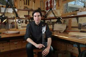 Mike Moreno poses for a portrait the shop of luthier Stephen Marchione Thursday, Feb. 11, 2016, in Houston. Moreno is an alum of the High School for the Performing and Visual Arts.  ( Jon Shapley / Houston Chronicle )