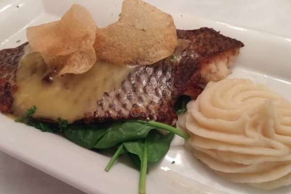 Spain, like all the countries across southern Europe, is the source for a wide variety of delicious, user-friendly wines. Here, grilled branzino at Bistro Mediterranean.
