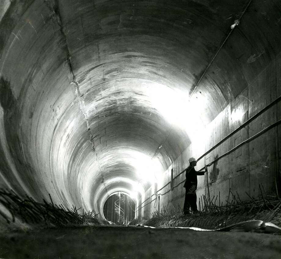 """The last tube section of the Transbay Tube was laid down in April of 1969. The first test train wouldn't actually go through the Tube until August of 1973. In August of 1969, with the tube connected but not yet operational, BART allowed the public to """"walk, run, or ride a bike under the bay."""" (Healy, p. 126) Thousands took part in the unique opportunity.  Photo: Duke Downey, San Francisco Chronicle"""