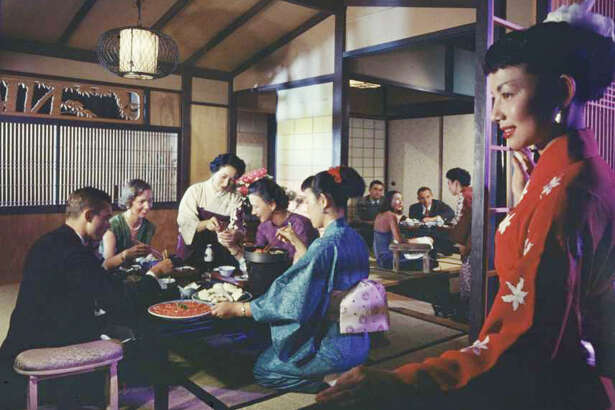 Waitstaff dressed in kimonos serve patrons at the Tokyo Sukiyaki restaurant on Fisherman's Wharf, San Francisco, California, 1956. (Photo by Nat Farbman/The LIFE Picture Collection/Getty Images)