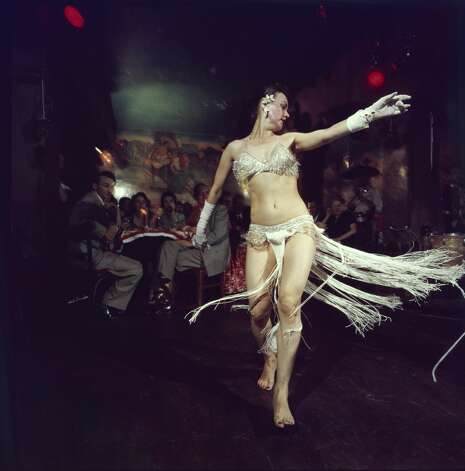 A dancer dressed in a white sequin bikini and elbow gloves performs for patrons at Sinaloa Mexican Cantina. The Sinoloa, located on Powell and Broadway, was a hot spot for decades, serving up Mexican food and Latin entertainment. Photo: Nat Farbman/The LIFE Picture Collection