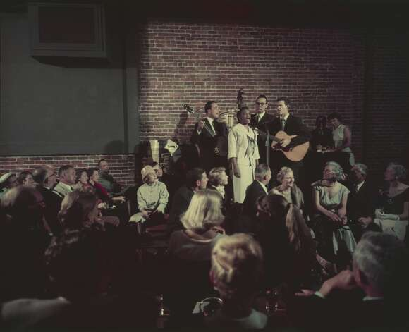 A four-piece band (guitar, banjo, upright bass and vocals) performs onstage for patrons at the famed hungry i. The hungry i, housed in the basement of the International Hotel, became the go-to place for rising stars. Barbra Streisand, the Kingston Trio, Vince Guaraldi, Dick Cavett and Woody Allen all performed there in the 1950s and 1960s. The brick wall backdrop became a standard for stand-up performers around the country. Photo: Nat Farbman/The LIFE Picture Collection