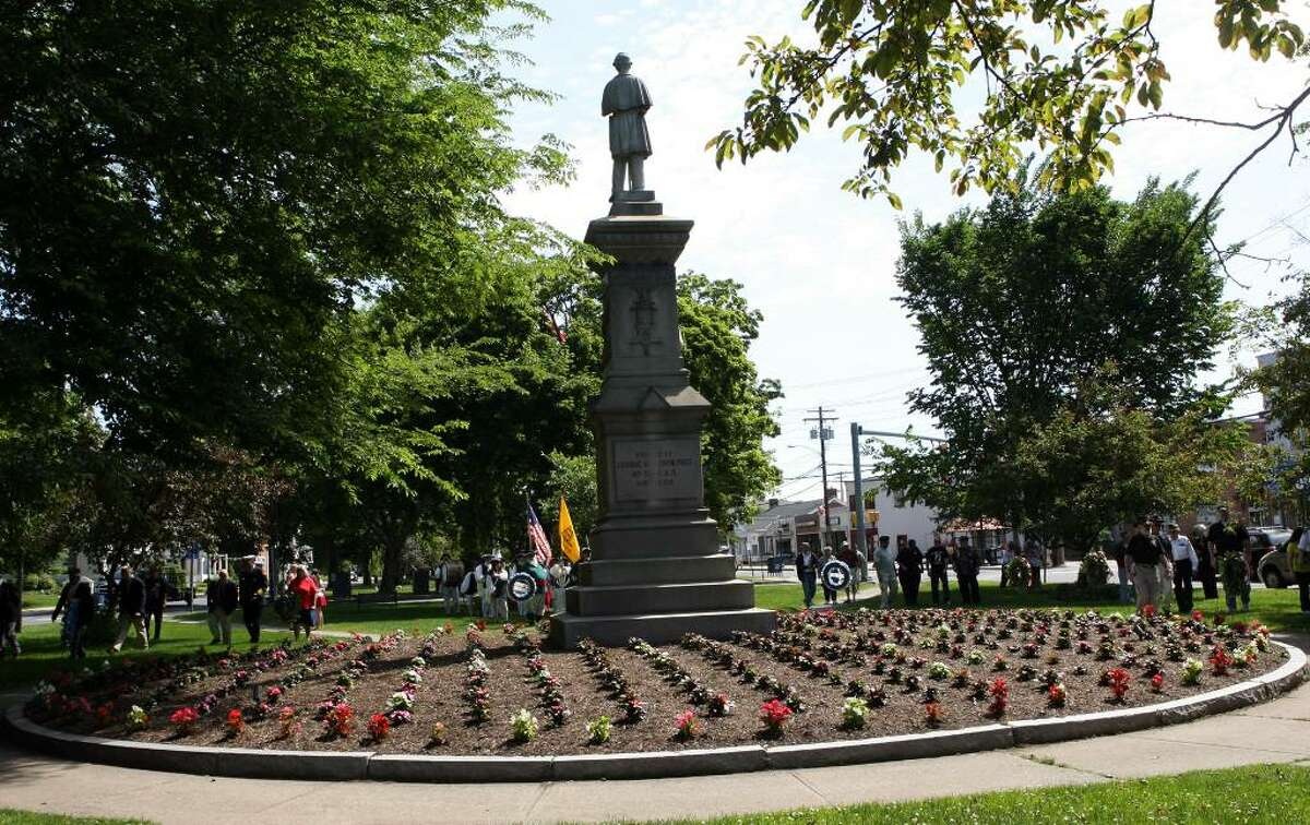 Members of Milford Volunteers Ancient Fife and Drum Corps, dignitaries, and veterans attend a wreath laying ceremony in Milford on Sunday morning.