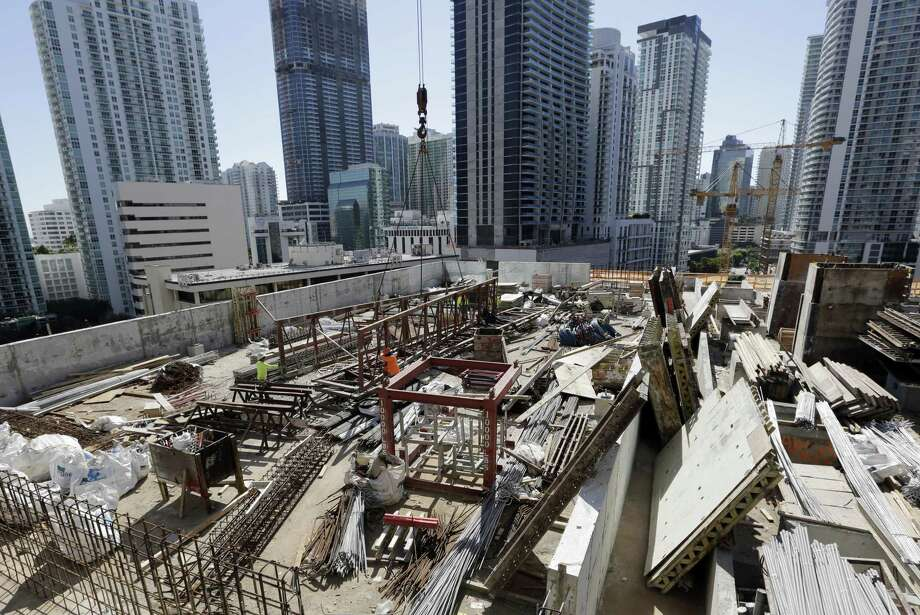 Builders cut back on construction spending in January by the largest amount in nine months, with weakness stemming from the biggest reduction in government activity in nearly 15 years, the Commerce Department reported. Photo: Lynne Sladky /Associated Press / Copyright 2017 The Associated Press. All rights reserved.