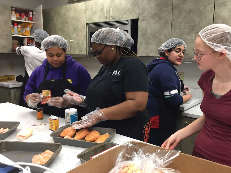 Working in SIUE's Campus Kitchen are, from left: Xavier Robinson, Kyron Artis, Cathern Brown, Monica Rodriguez and Shift Leader Taylor Hoeg. Photo: Julia Biggs • Intelligencer